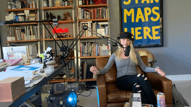 Anne Martin recording a podcast in the NOT REAL ART Studio
