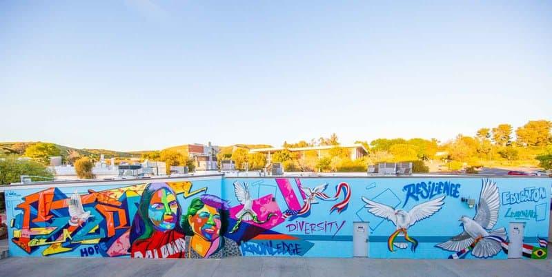 Graffiti artist Man One creates incredible murals using bright candy colors.