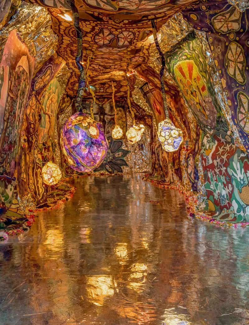 Artist Laurie Shapiro patches together handmade screen prints, sewn fabric, and paintings to create fully immersive spaces that transport participants to another world.