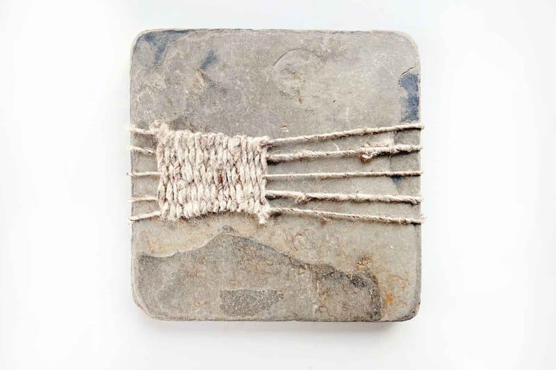 Fiber artist Emma Freeman combines found natural materials with fuzzy thread, woven and then wrapped around brambly bird nests and knobby birch bark strips.