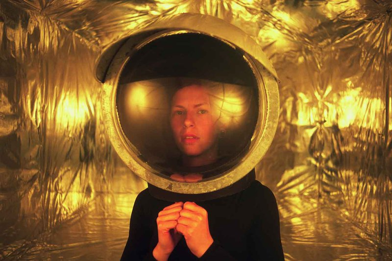 Photographer April Winter snaps glossy self-portraits that explore the effects of isolation on the human mind through a science fiction lens.